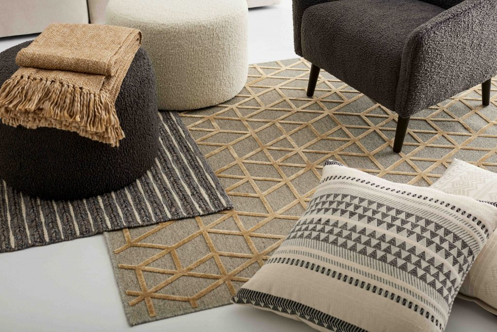 "Fabrics: multiplication of rugs, patterned cushions, warm throw and armchairs in ""sheep's wool""."