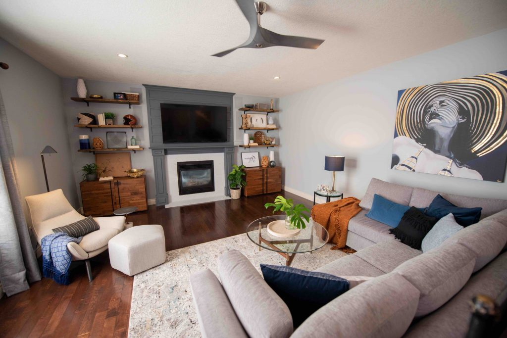 Family Room composed of a fabric sofa in grey, an area rug on the floor, a wall art, an accant chair and a coffee table. Discover Scott's tips to renovate your own family room!